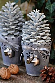 Advent decor: white pine cones in zinc flowerpots