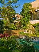 Modern residential complex with brick facade and pool in garden