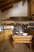Renovated country home with a modern, wood and steel kitchen, antique kitchen table on an old plank floor