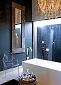 Bathroom with modern, free-standing bathtub and transparent, retro Plexiglas chair