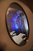 Spa room reflected in mirror on wall