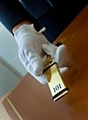 Hotel valet holding room key
