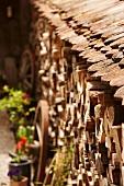 Wood pile next to a farm house