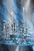 Crockery and silver candlesticks