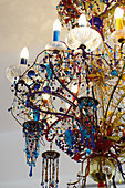 Chandelier decorated with blue glass beads