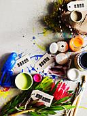Paint pots, flowers, bird figurine and seashells
