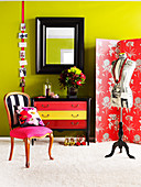 Tailor's dummy in front of screen, mirror with wooden frame and upholstered chair in bedroom with spring green wall
