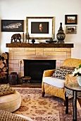 Sitting room with fireplace and antique sculptures on the mantlepiece