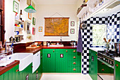 Retro kitchen with wooden worksurface and green-painted base units