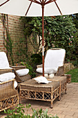 Rattan furniture and parasol on terrace