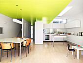 Open-plan kitchen with dining area and suspended ceiling