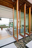View through bank of open swivel windows into modern living area with panoramic view