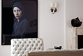 Modern portrait of woman behind quilted back of elegant recamiere in postmodern living room