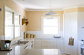 U shaped kitchen units with white base units in a light kitchen