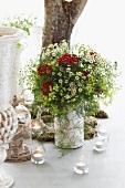 Summery flower bouquet and tea lights