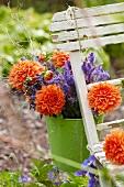 A bunch of summer flowers on a garden chair