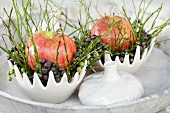 Winter table decoration with apple, berries and grasses