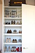 View of women's shoes in shoe cabinet with open door