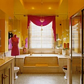 Yellow walls in bathroom with Oriental touch