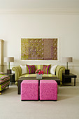 Elegant Art Deco-style living room - stools upholstered in pink and traditional sofa between table lamps on side tables