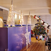 Creative Christmas decorations in open-plan designer kitchen of loft apartment