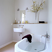 A half-filled bath tub in a minimalist bathroom