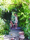 Children playing boules in garden
