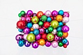 Many colourful Christmas tree baubles