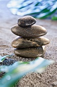Stack of pebbles with water droplets