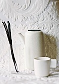 Vanilla pods, white jug and cup