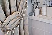 Elegant brocade curtain in bathroom with beaded tie-back