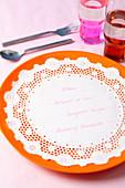 A doily used as a menu on a plate