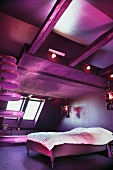 Modern attic bedroom with funky pink lighting