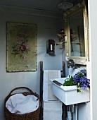 Corner of vintage bathroom with sink and framed mirror