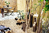 Bonsai trees and seating area in designer garden