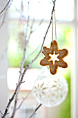 A snowflake biscuits hanging on a twig