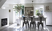 Country style dining room with dark wood chairs at white table