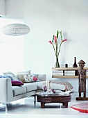 Modern sofa and ethnic-style coffee table in minimalist interior
