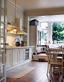 Dining area in country house kitchen with view of garden