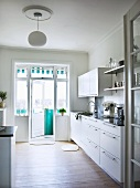 Functional kitchen with open balcony door