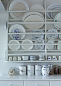 Kitchen shelving with country-house-style crockery and storage jars