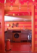 Funky kitchen in orange and red stripes