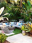 Grey sofa set with striped cushions on terrace