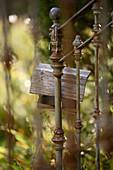 Bird table hanging on metal railing