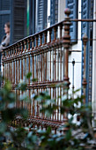 Rusty, traditional balcony balustrade in front of house