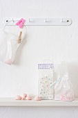Sweets in plastic bags on hook and shelf