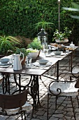 Long, set table on terrace seating area