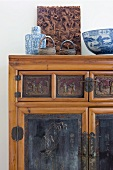 Oriental blue and white bowl on bamboo cabinet