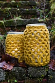 Lanterns made of preserving jars with crocheted covers