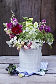 Wild flower bouquet with stocks, white yarrow and ground elder